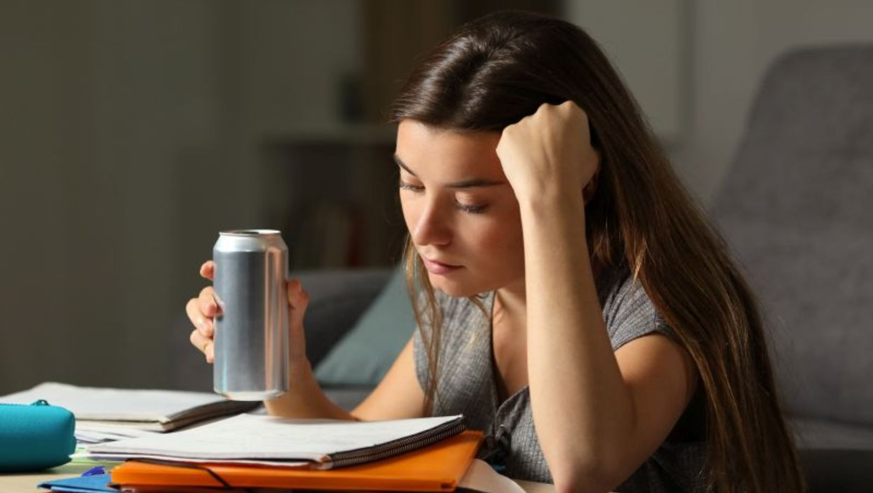 teen with energy drink