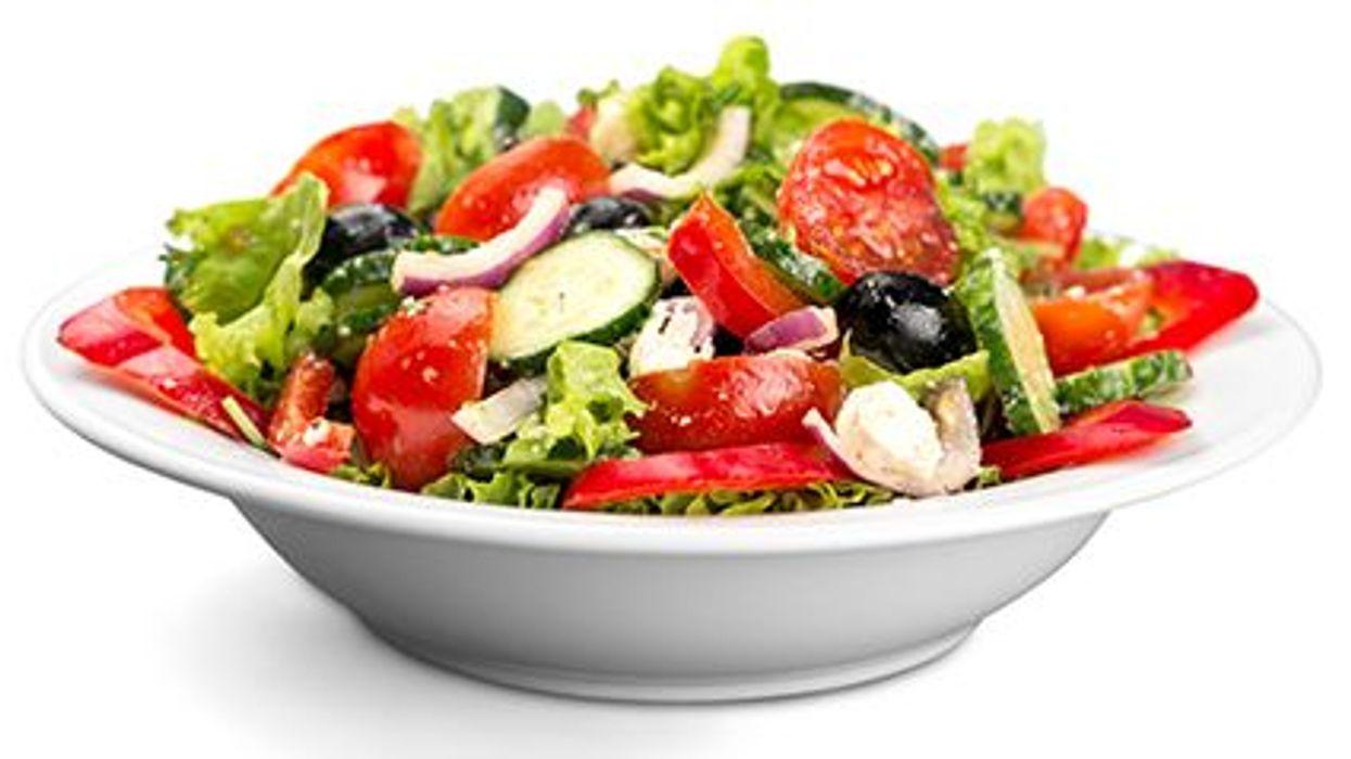 a bowl of Greek salad