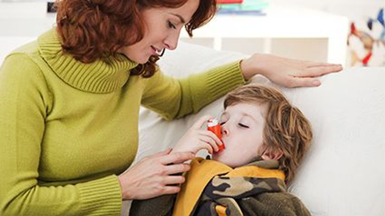 a mother giving a child an inhaler
