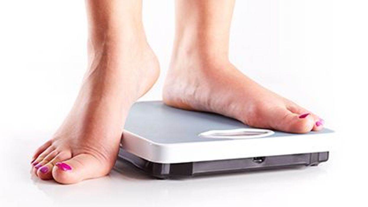 a female\'s feet on a scale