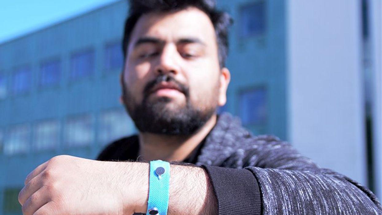 Co-creator Muhammad Umair wears prototype wristband