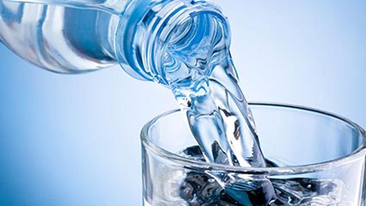 drinking water in a plastic bottle
