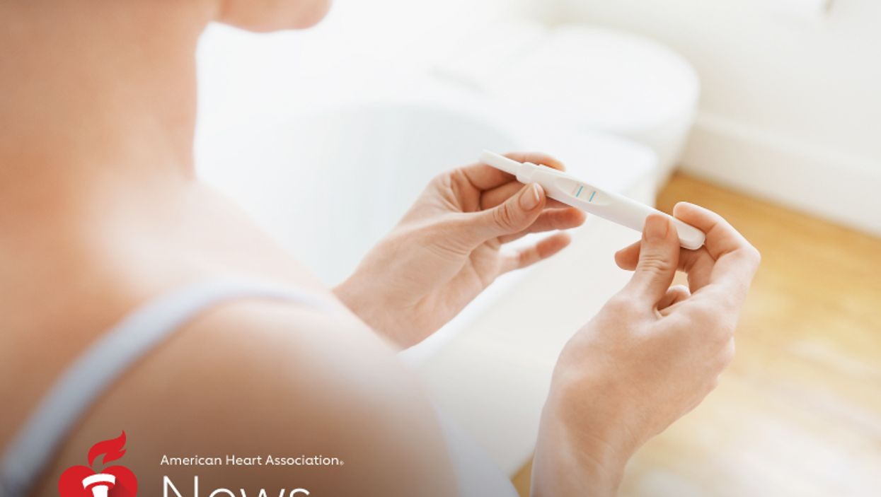 a woman checking her pregnancy test