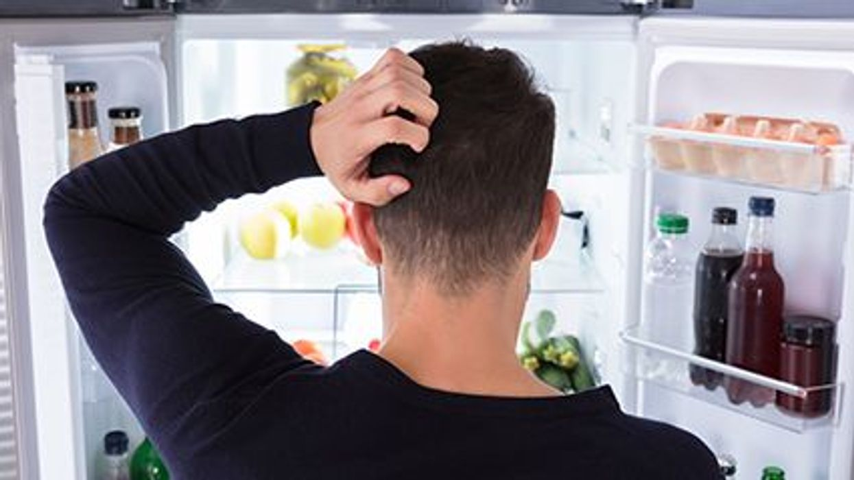 a man in front of the opened fridge