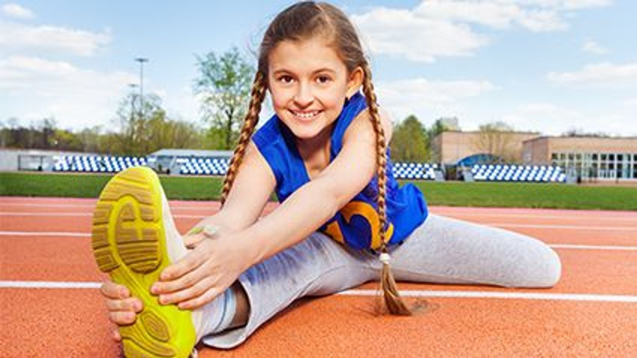 a girl stretching  on a track