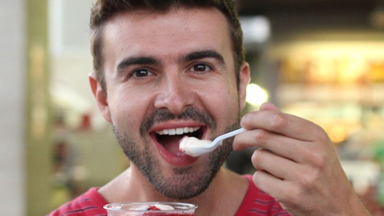 Man eating yogurt