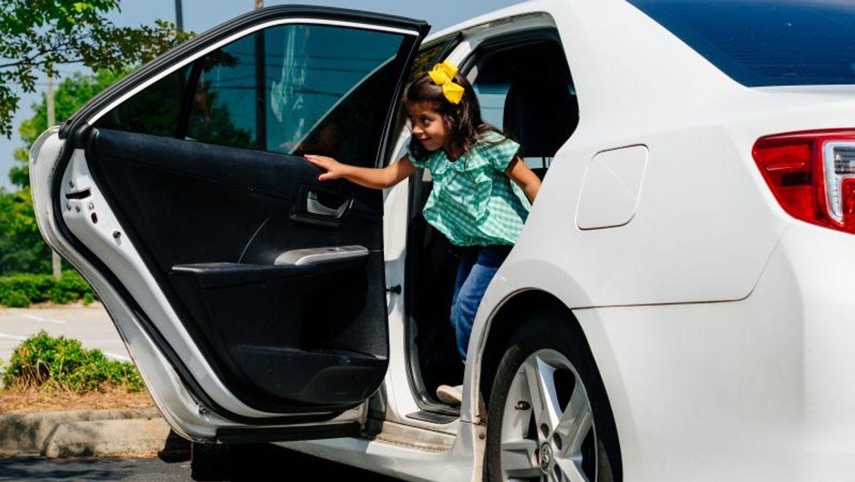 girl exiting car