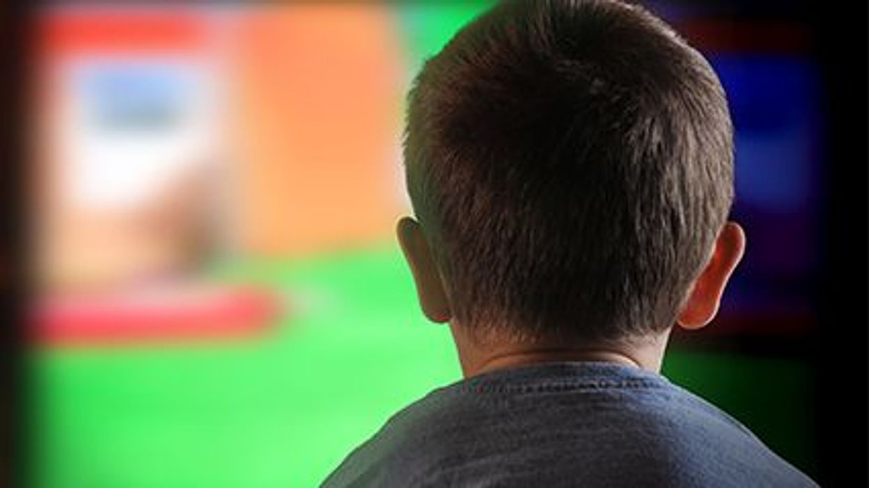 a boy in front of the TV