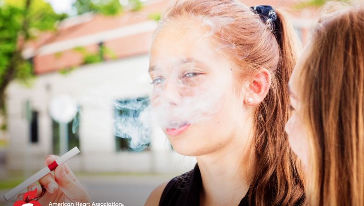 a young girl vaping