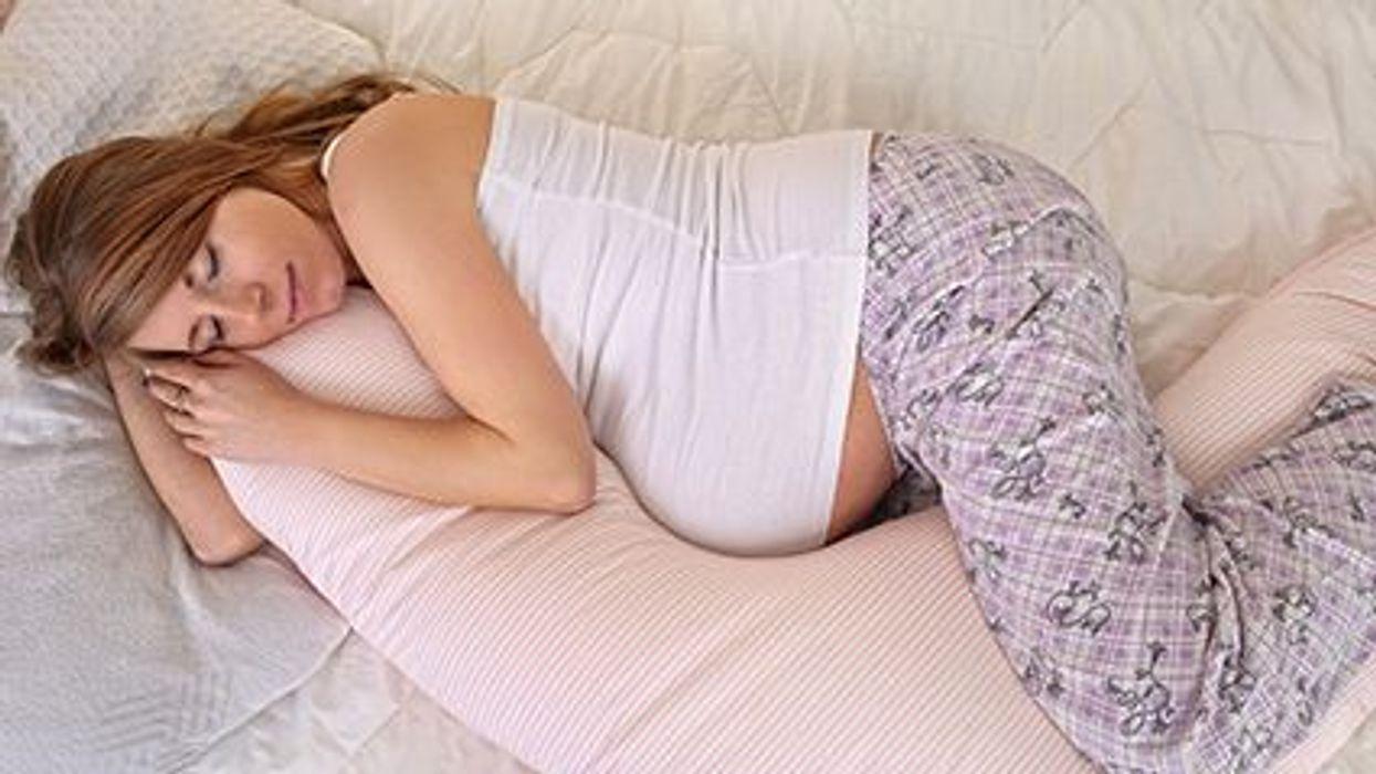 a pregnant woman sleeping