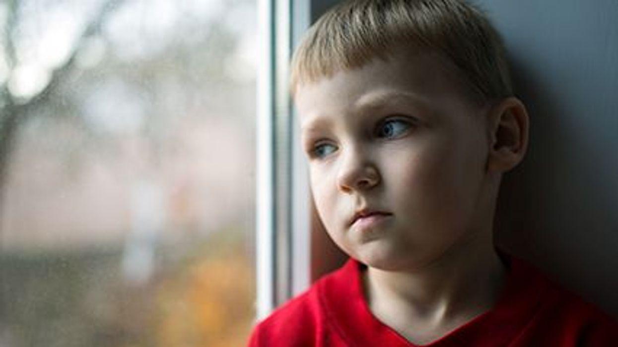 a boy looking sad