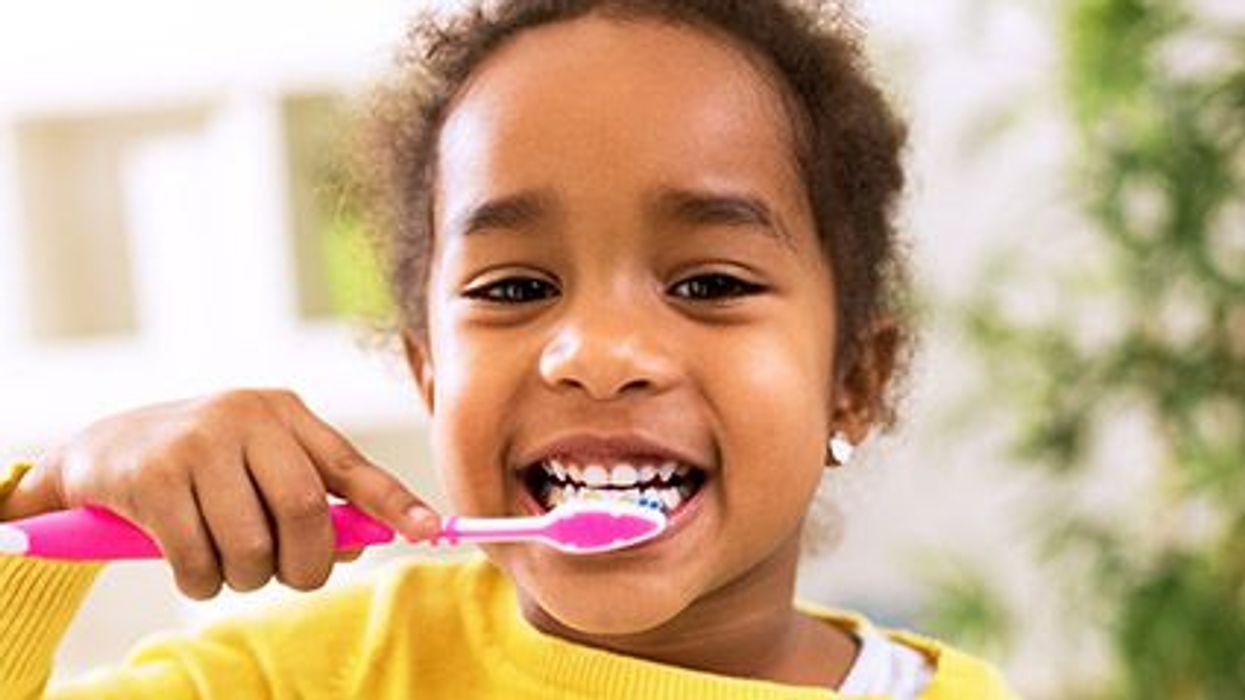a girl brushing her teeth