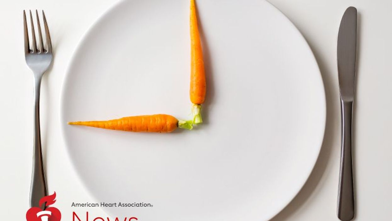 carrots on a plate with a fork and a knife to the sides