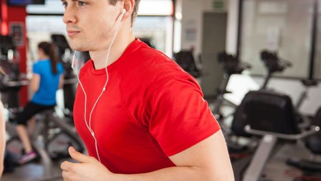man on treadmill listening to music