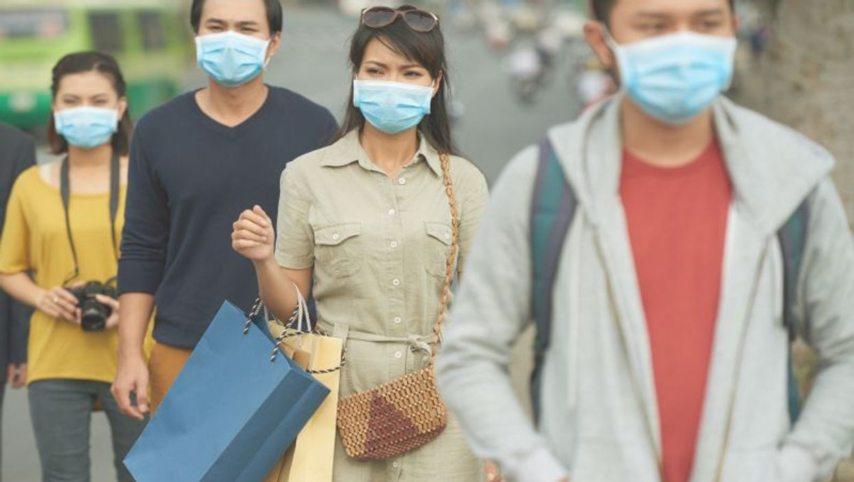 Wearing surgical masks to protect against viruses