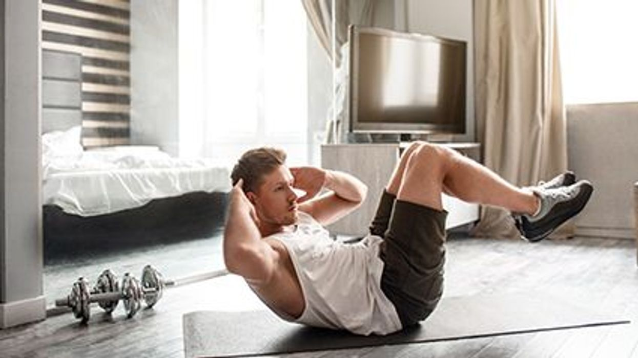 a man exercising on the floor