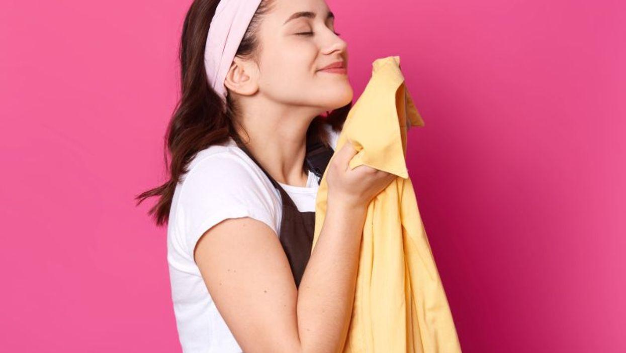 woman smelling shirt