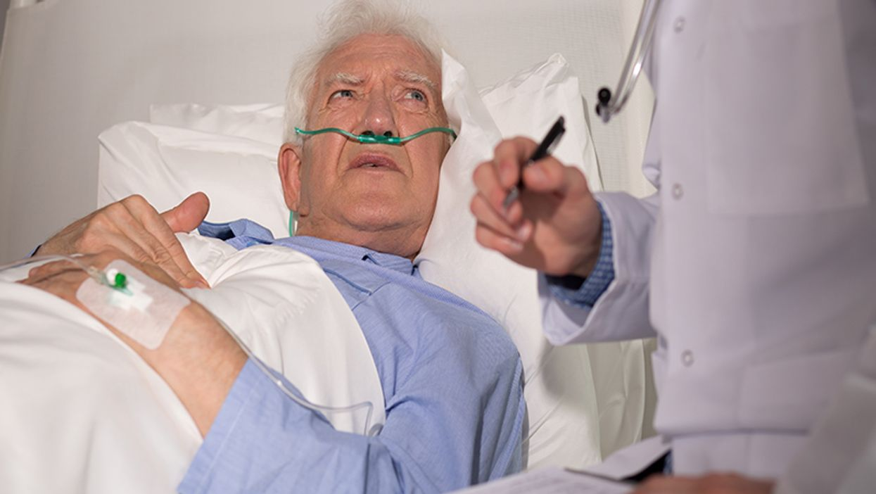 eldery man examined by a doctor