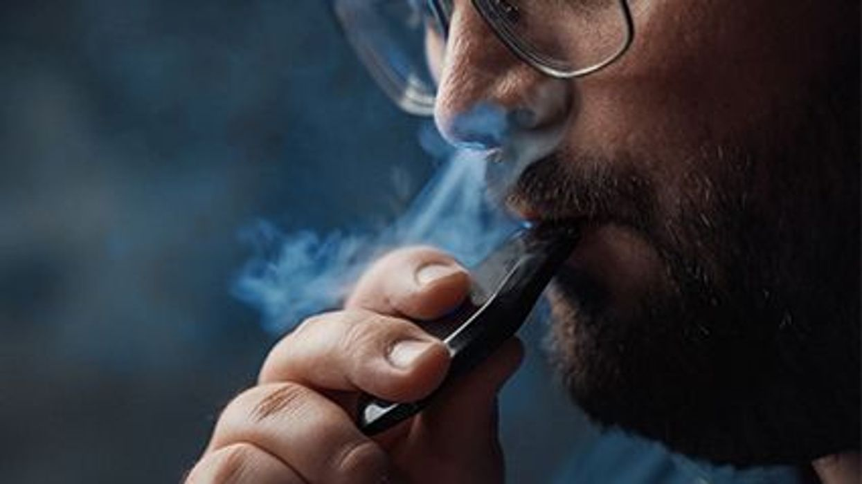 a person smoking e-cigarette