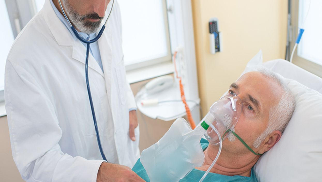 elderly male patient with respirator