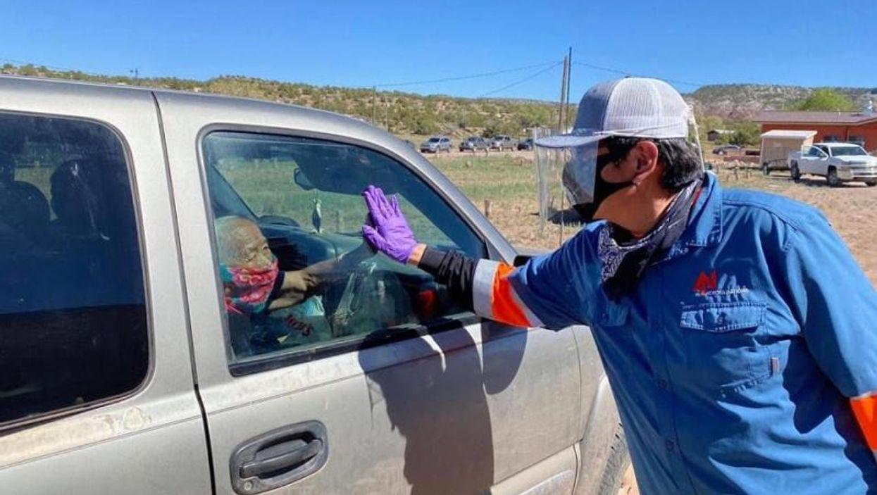 Pres. Jonathan Nez of Navajo Nation distributes food