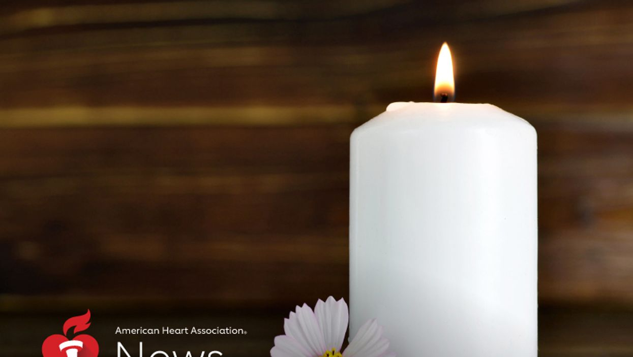 a candle with a flower
