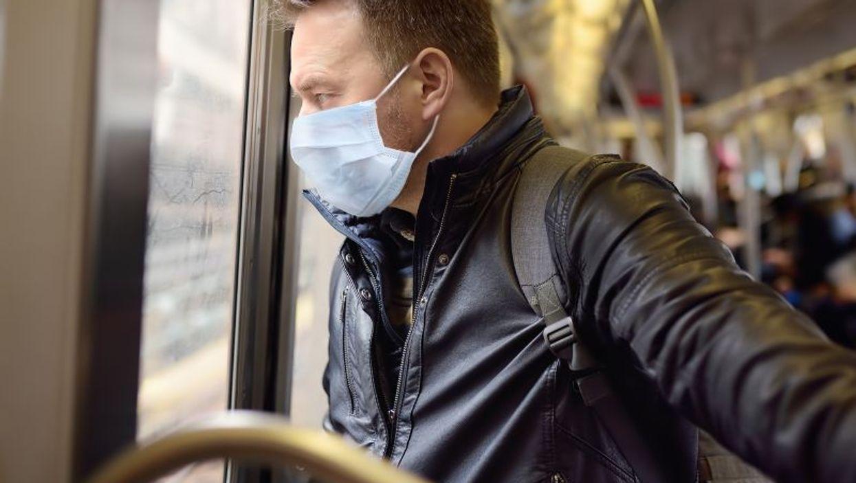 man on train wearing mask