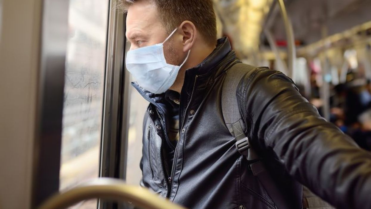man on train wearing mask