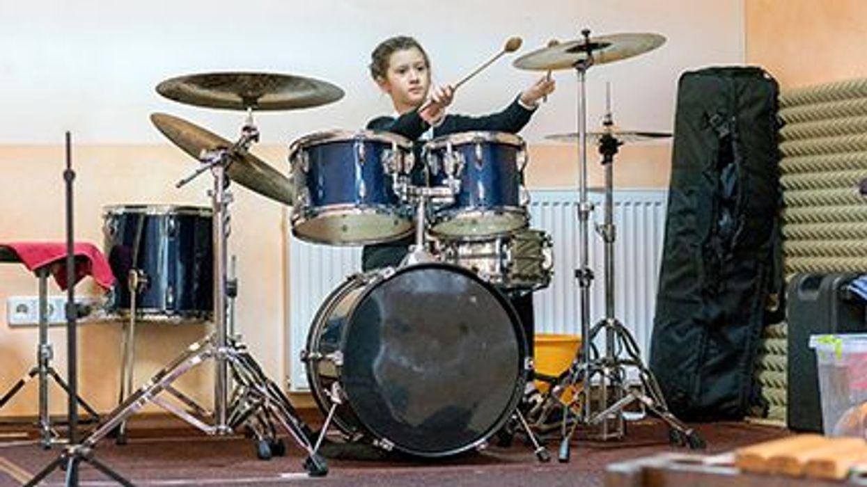 a girl behind drums