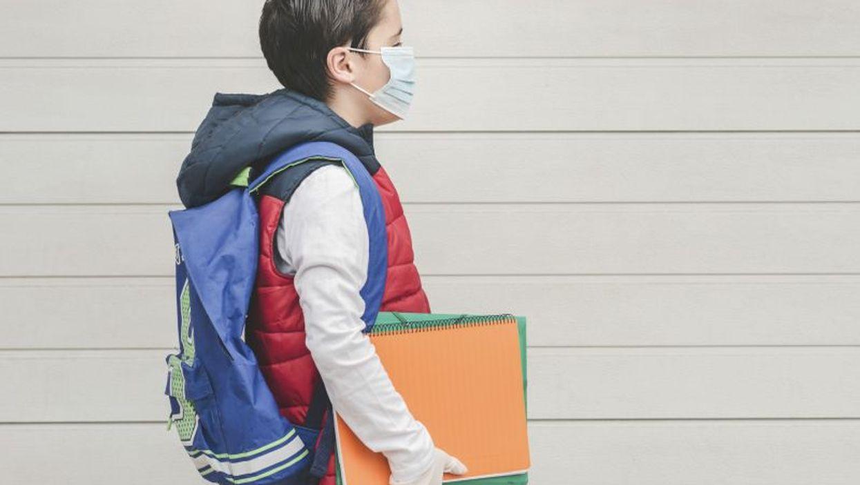 Boy wearing mask to school