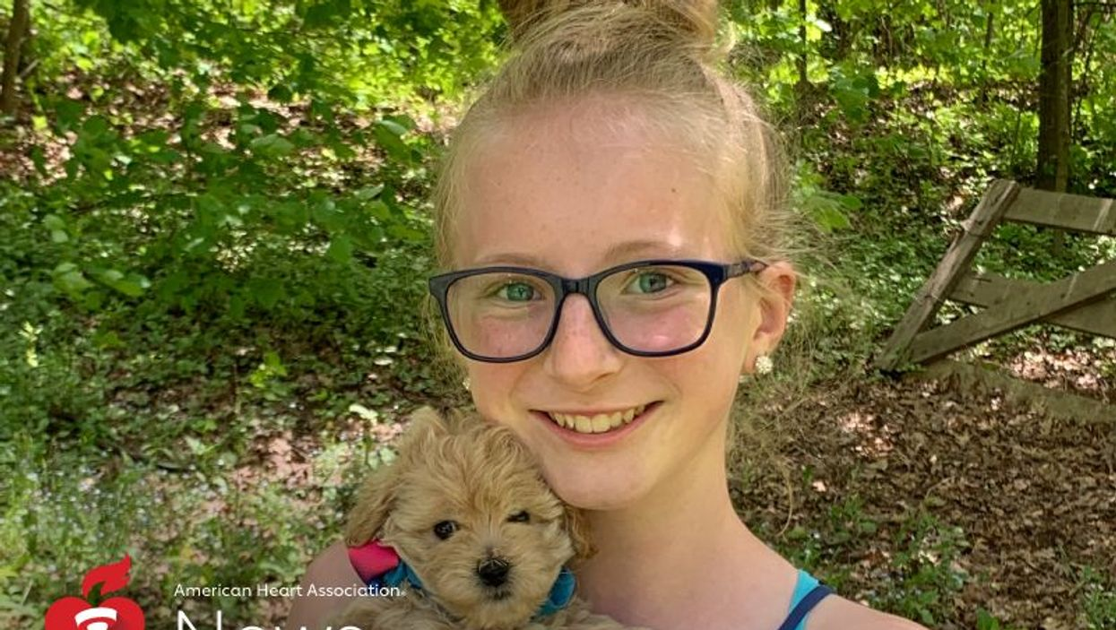 Heart disease survivor Abrielle Tallquist with her family's new puppy