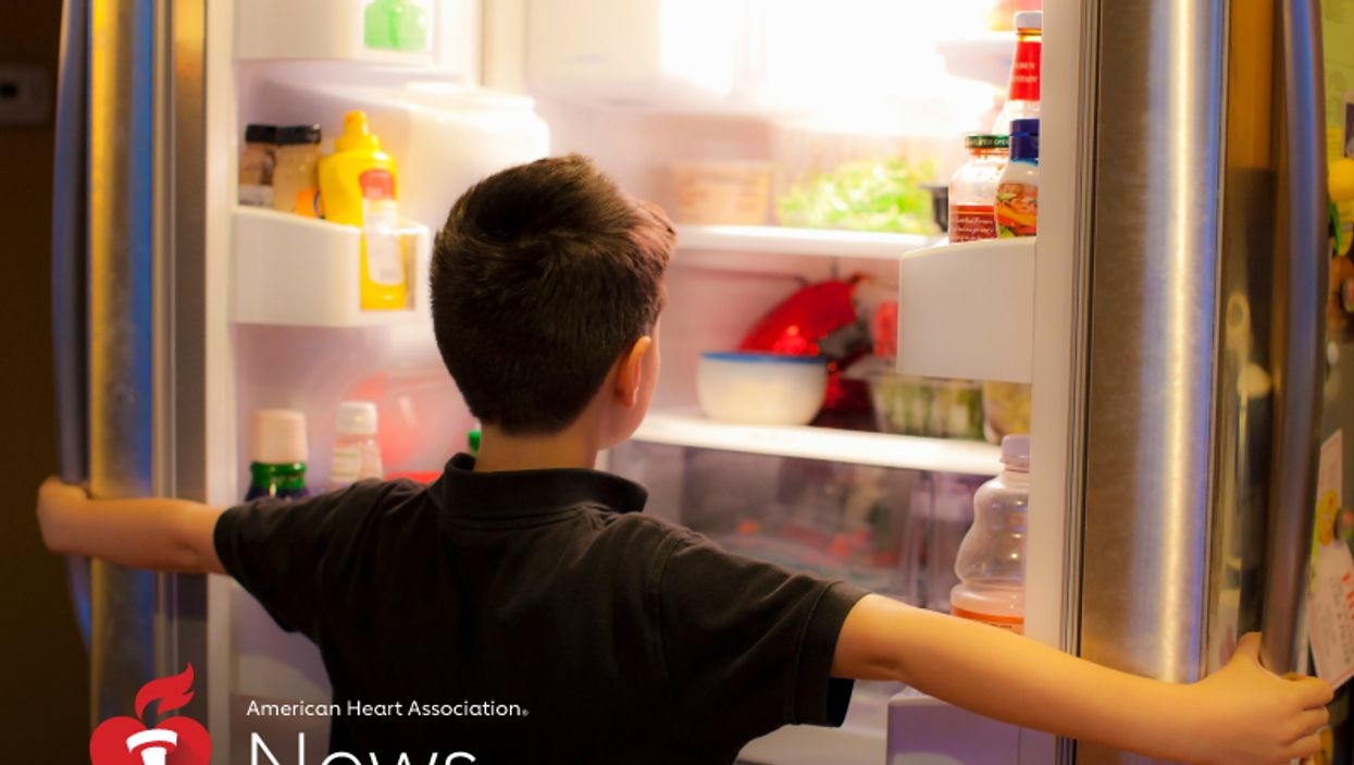 a boy looking at the fridge