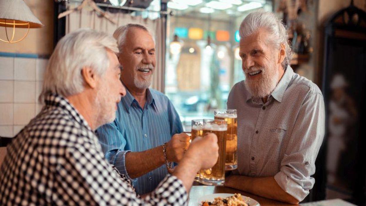 man senior beer drinking