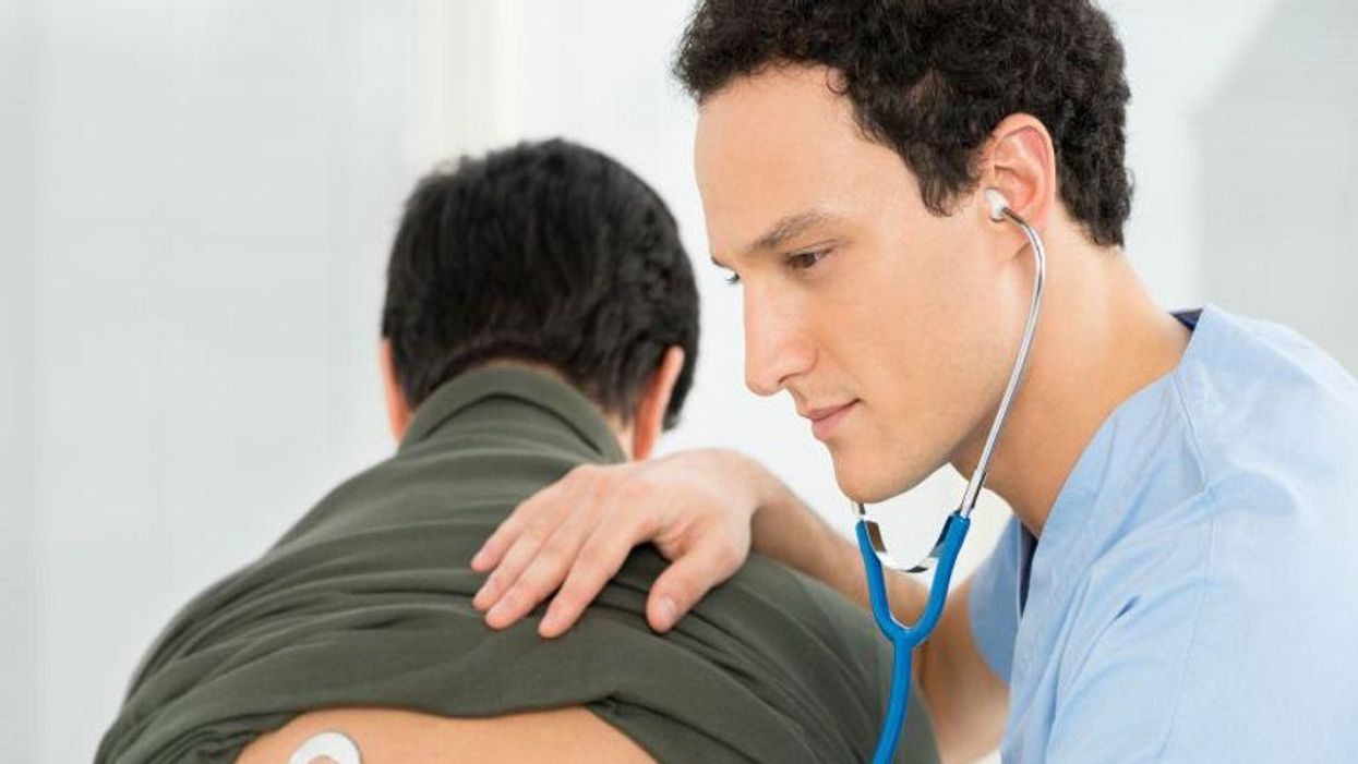 doctor listening to lungs