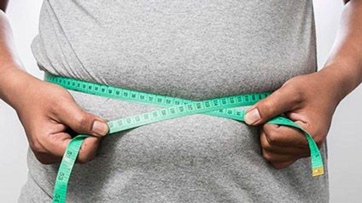 a person measuring his waist