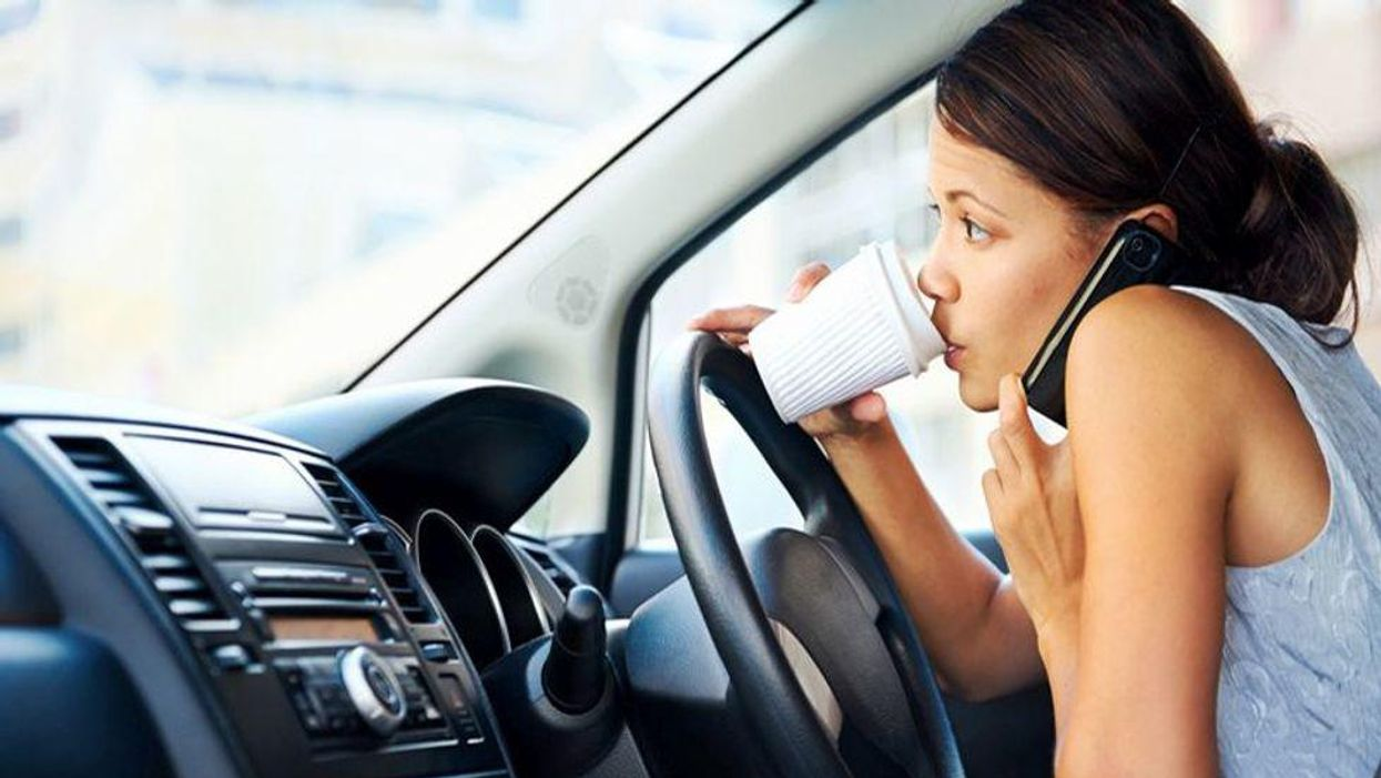 driver sipping coffee