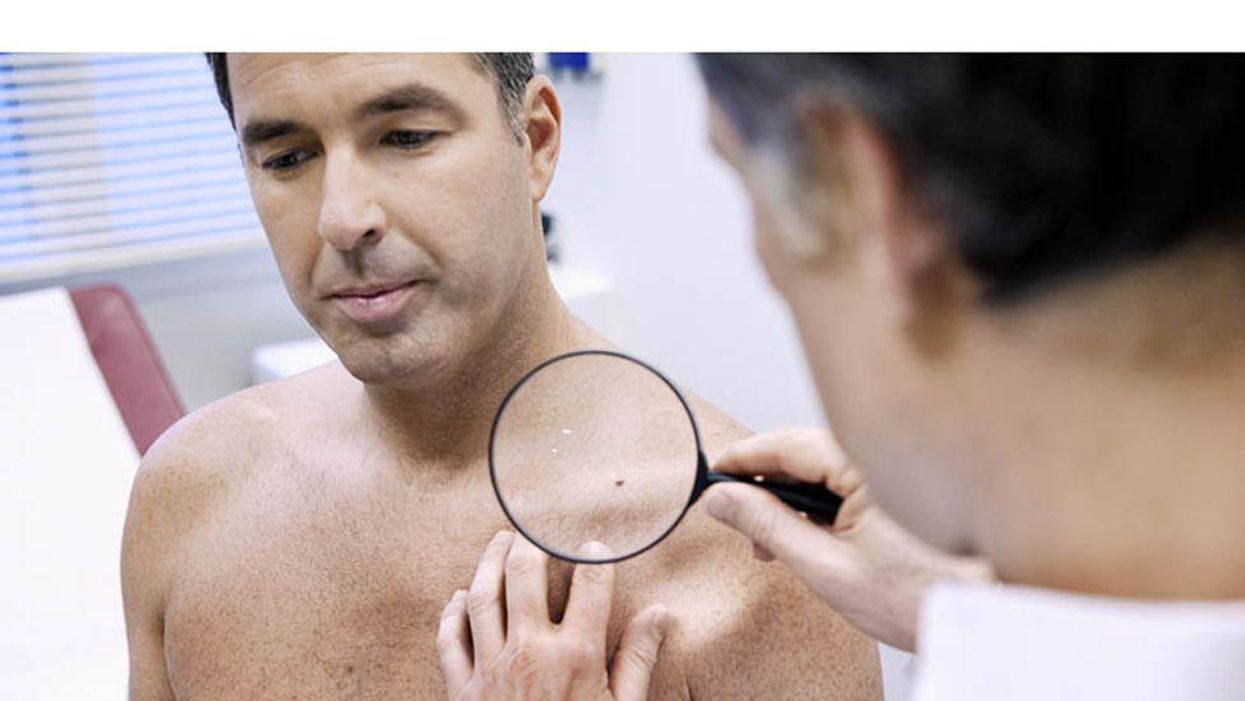 doctor examining patient skin