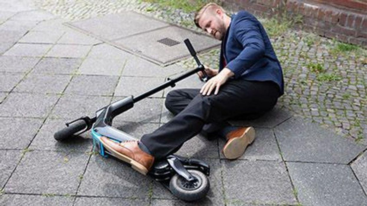a man falling from the scooter