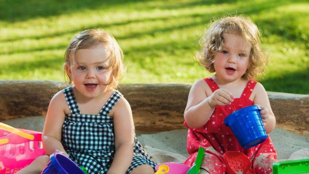 toddlers in sandbox
