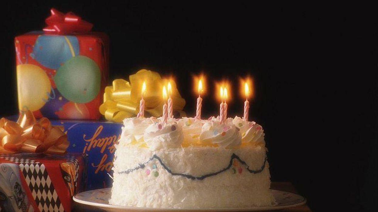 birthday cake with candles and presents