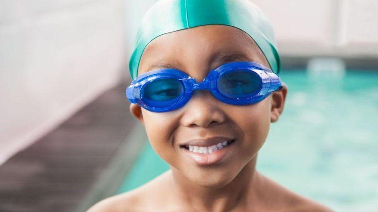 African American boy swimming