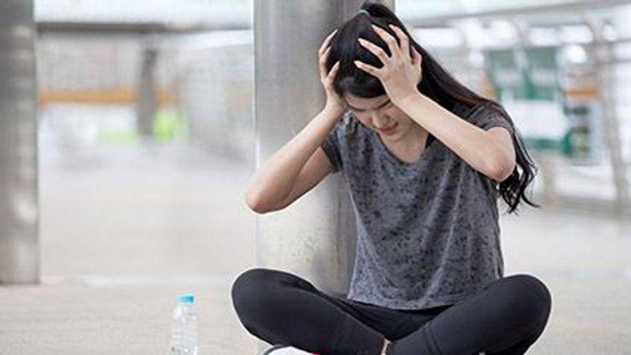 a girl with a headache pain