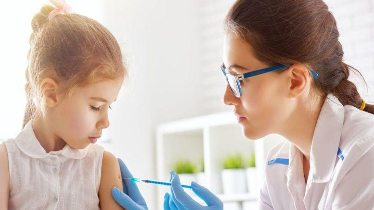 toddler getting vaccine