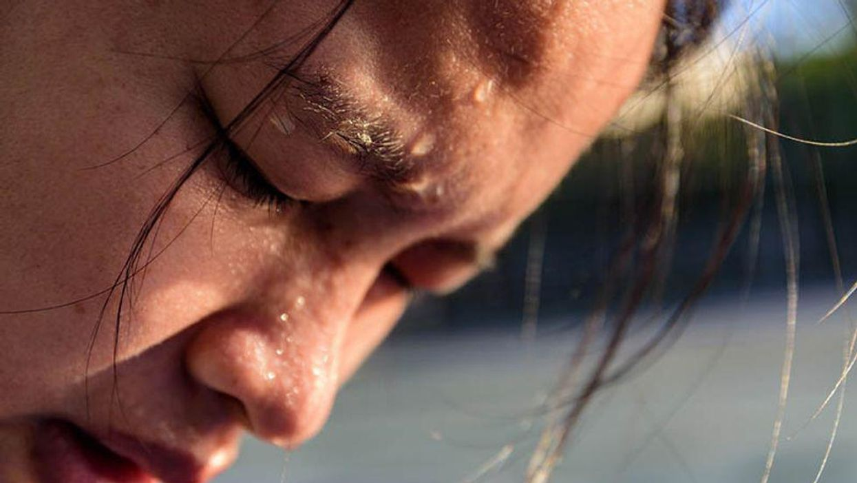 sweat dripping on woman's face