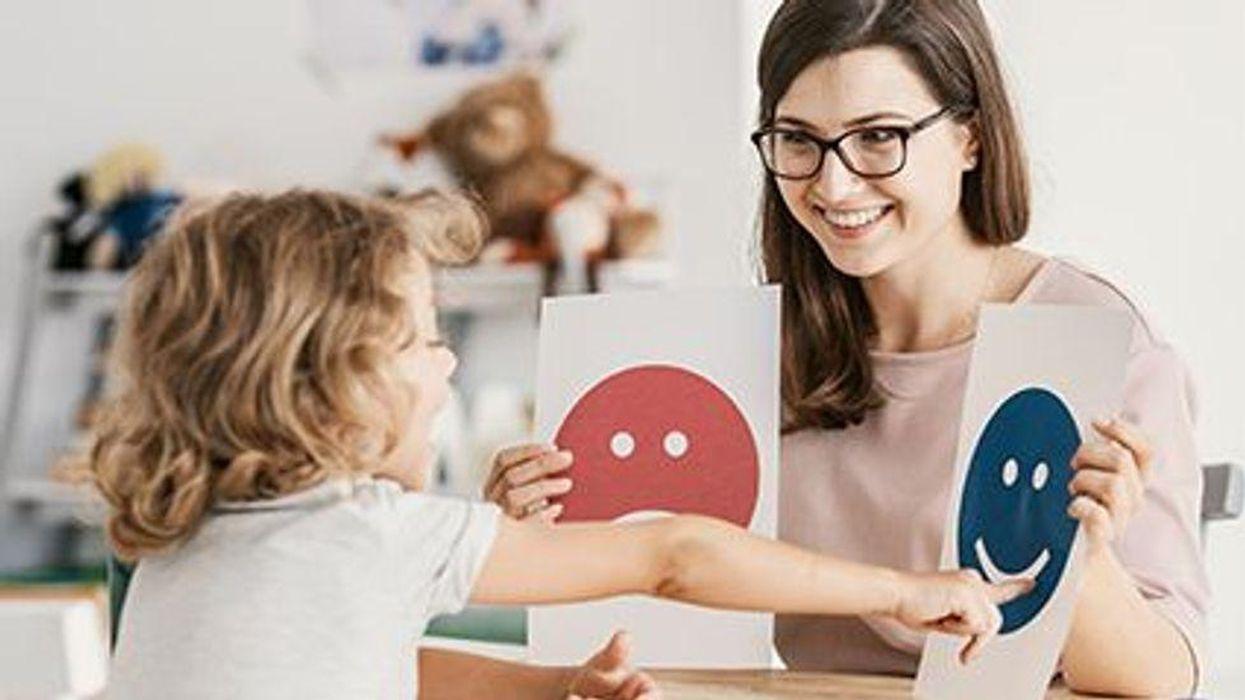 a woman teaching a child