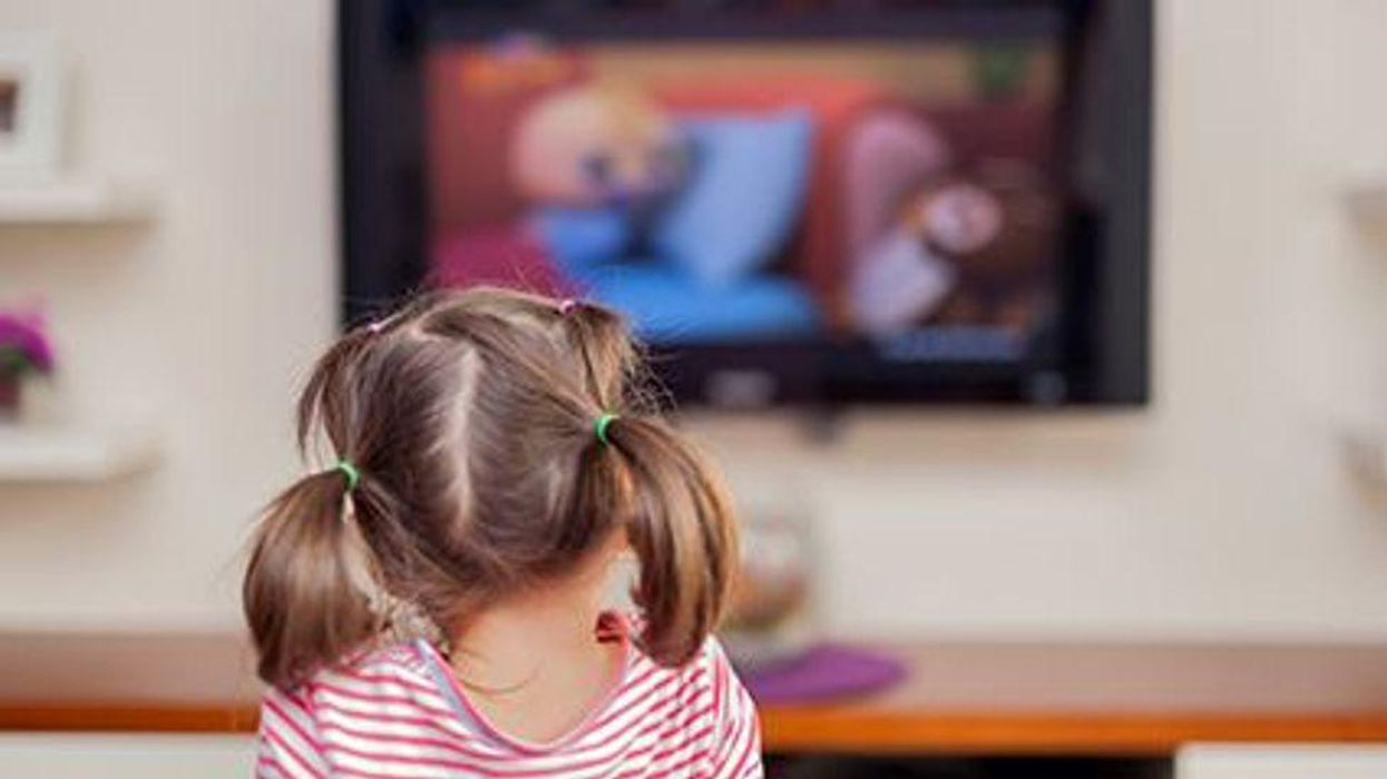 a girl in front of tv
