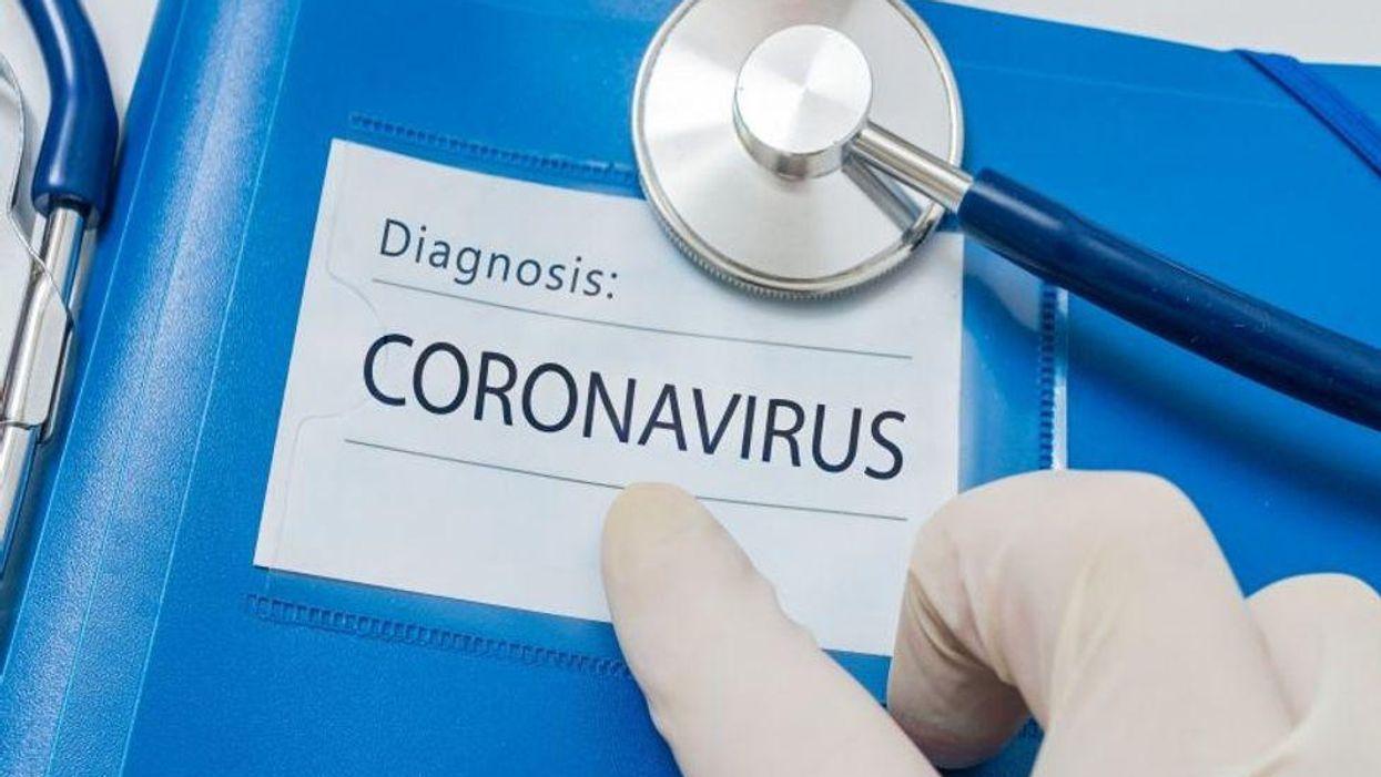 blue folder with diagnosis coronavirus on front