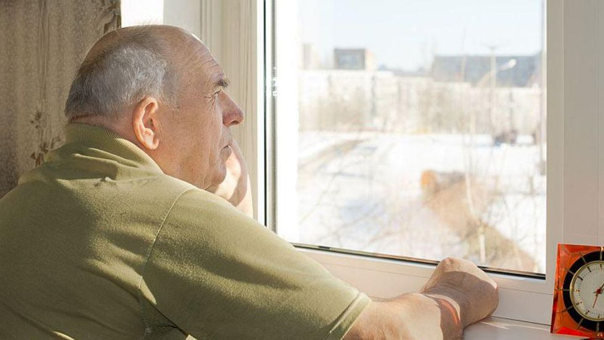 man with alzheimer\'s stares out of window
