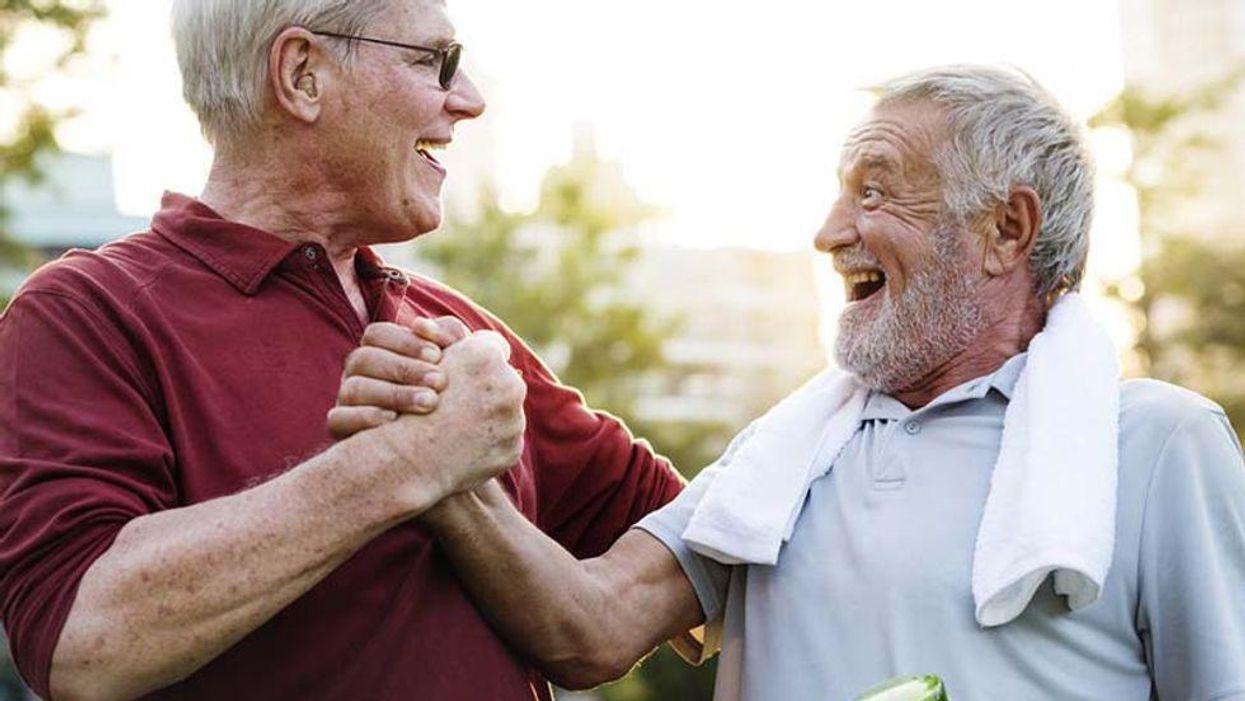 two older man shakig hands after exercise