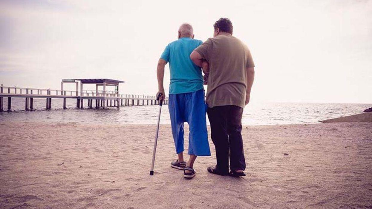 elderly walking on the beach